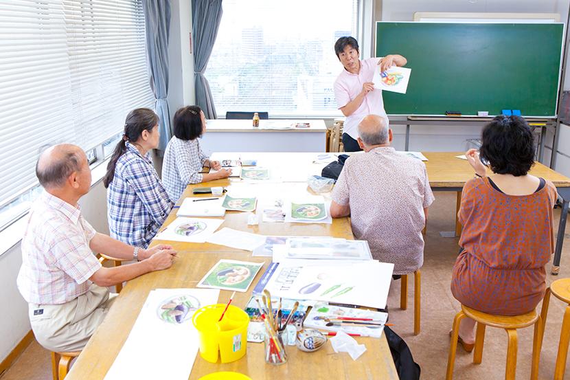 松岡伸一が撮影した水彩画教室で教える福井良佑先生の写真
